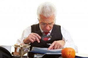 6357963-senior-citizen-reading-the-fine-print-in-a-contract[1]