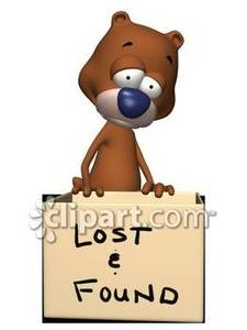 a_lost_dog_standing_behind_a_box_wanting_to_be_found_royalty_free_080711-221551-579037[1]