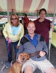 Board Members Margaret Fitzgerald and June Solla, Former Board Member Robert Lauri, along with Spartacus and Shelby (Shelby was a little camera shy.)